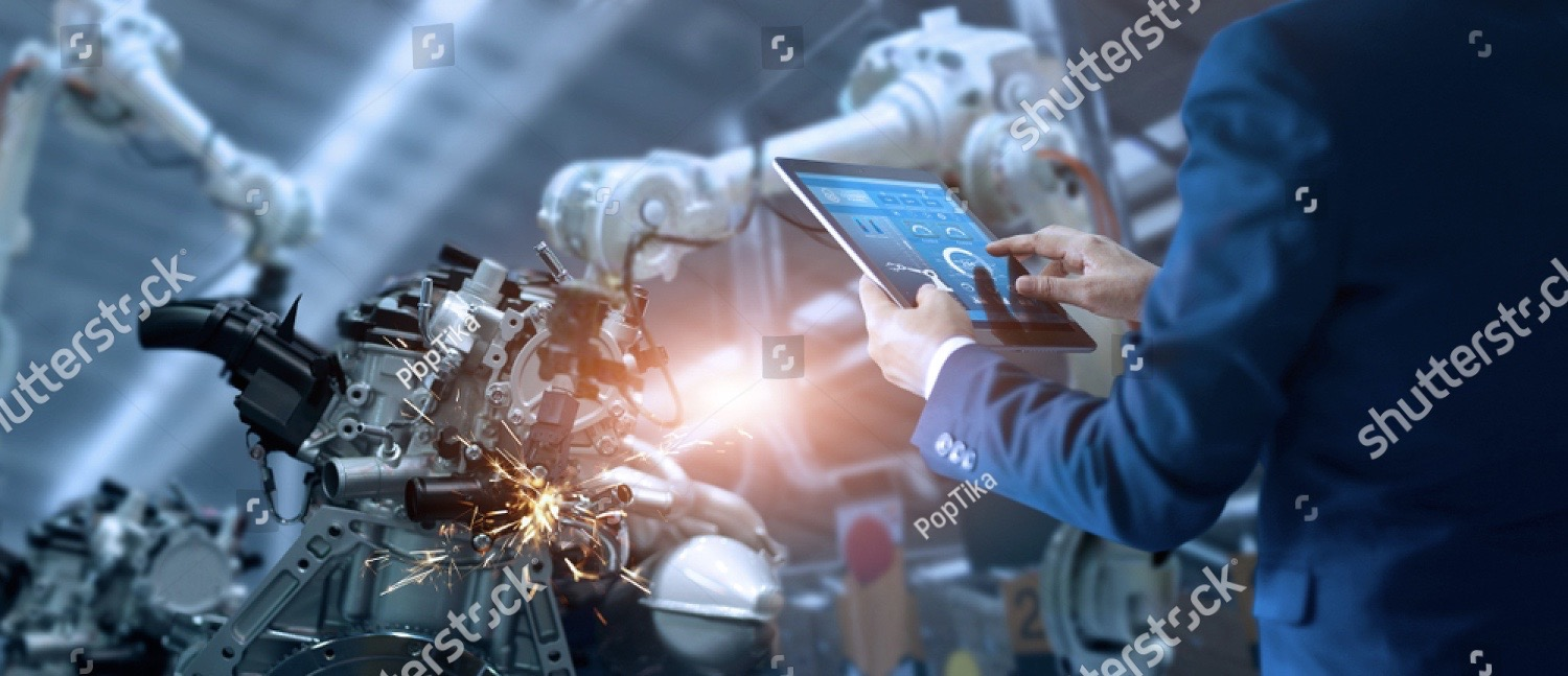 stock-photo-manager-engineer-check-and-control-automation-robot-arms-machine-in-intelligent-factory-industrial-1119927341
